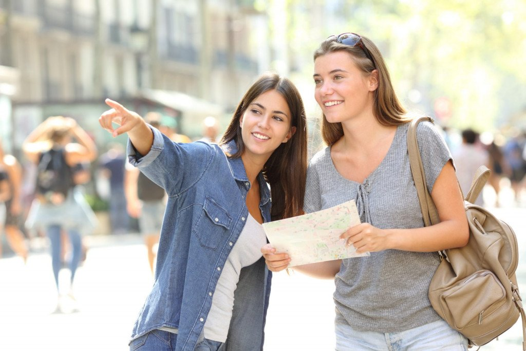 Woman helping tourist with directions