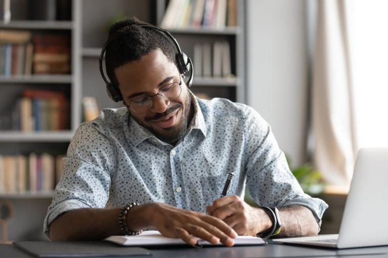 Travel planning deals, man listening to headphones
