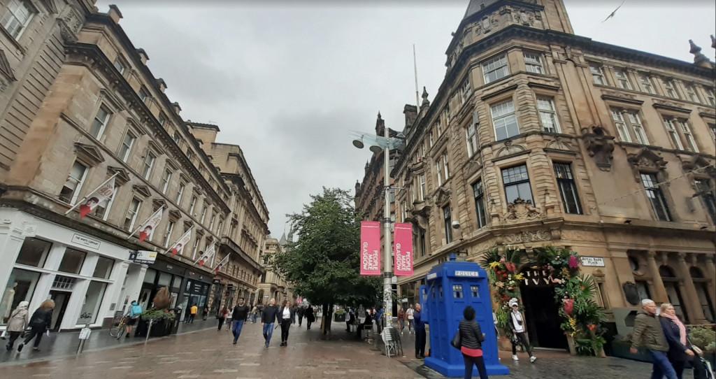 People walking on a street in Glasgow Scotland