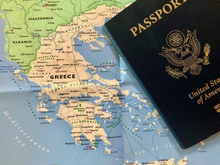 Plan trip to Greece passport and Greek map